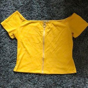 Yellow/ gold zip shirt.